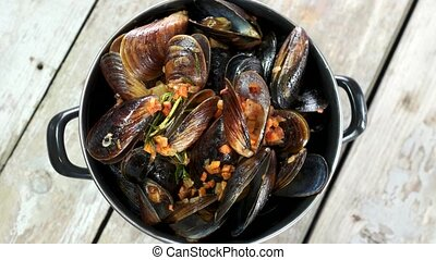 Steamed mussels in white wine. Cooked clams top view.
