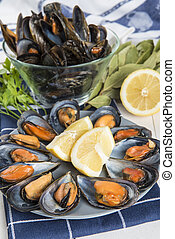 Steamed mussels with lemon ready to be eaten