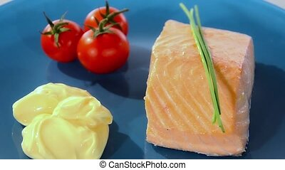 Steamed salmon on a blue plate