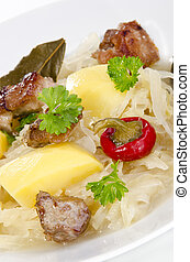 Steamed sauerkraut with grilled pork and potatoes