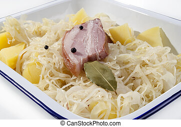 Steamed sauerkraut with pork and boiled potatoes