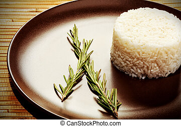 steamed - Steamed white rice on a brown plate.