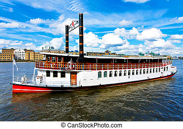 Retro style steam boat at river Thames