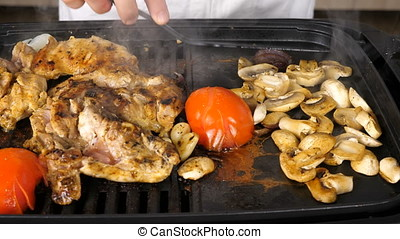 Steaming and smoking vegetables and meat on a grill
