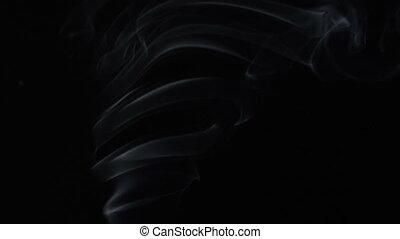 Steaming aroma stick - White smoky cloud of aroma stick on...