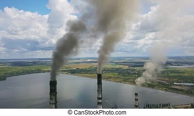 Steaming chimneys of power station - Three steaming chimneys...