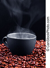 Steaming coffee - A grey cup with steaming coffee over ...