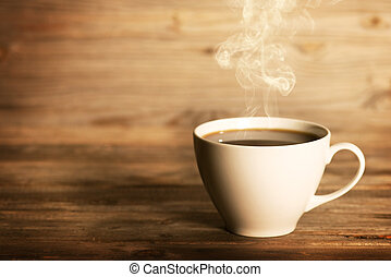 Steaming coffee in white mug - Steaming coffee in white cup...