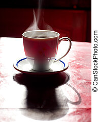 Steaming coffee on the table