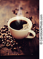 Steaming cup of freshly brewed coffee. Shallow depth of...