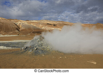 Steaming fumaroles at Hverir Namafjall geothermal area in north Iceland