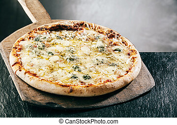 Steaming hot four cheeses Italian pizza