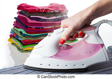 Steaming iron - Iron and ironed, arranged clothes on ...