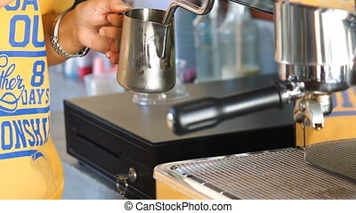 Steaming milk and clean steam wand by barista