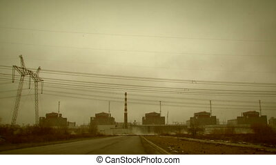 Steaming nuclear power station - A view of a nuclear power...