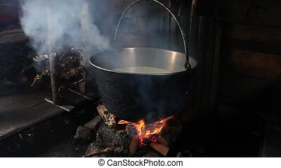 Steaming old-fashion pot over fire