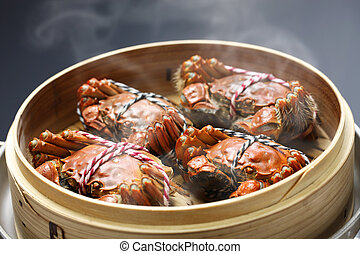 steaming shanghai hairy crabs in bamboo steamer, chinese...