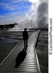 Steaming Spring in Wilderness at Yellowstone National Park Silhouette of Person Walking