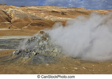 Steaming sulphur fumaroles at Hverir Namafjall geothermal area in north Iceland