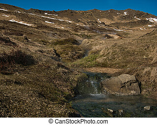 Steaming thermal water in the mountains of Iceland