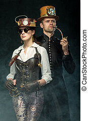 Steampunk couple. Man with a pipe and a girl with glasses...