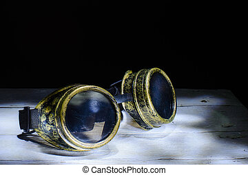 Steampunk glasses metal collage. light brush