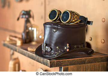 Steampunk interier. Hat, goggles, manometer, lamps.