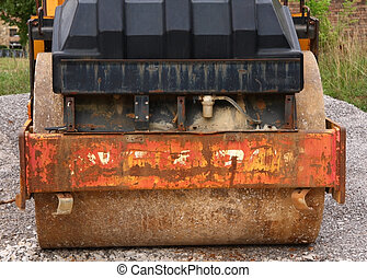 Front of an old, rusted, beat up, steamroller.