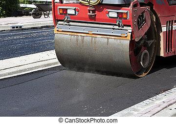 Steamroller in action on asphalt
