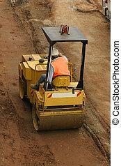 Steamroller - Man using a steamroller