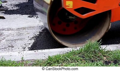 Steamroller flattens asphalt - Steamroller smoothing hot ...