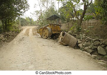 The steamroller has not withstood the road full of rocks