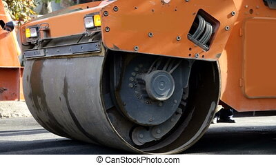 Steamroller with flashing lights
