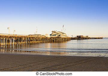 Stearns Wharf in Santa Barbara - A low, setting sun casts a ...