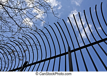 steel bars - edge of an old bended metal bars railing...