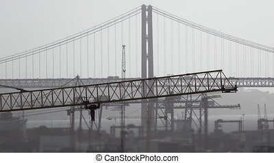 Steel bridge and crane moving - Long shot, misty day,...
