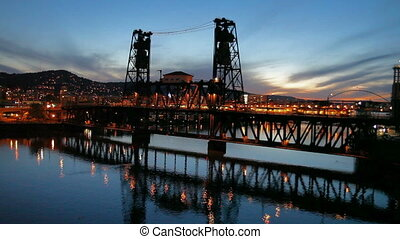 Moving Traffic on Steel Bridge in Portland Oregon Downtown Blue Hour Sunset with Water Reflection along Willamette River at Night 1920x1080