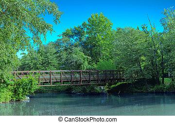 Steel Bridge Over Murky River
