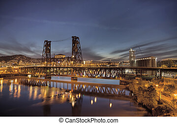 Steel Bridge with Broadway and Fremont Bridges Over Willamette River at Evening Blue Hour in Portland Oregon