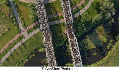 Steel bridge railway aerial drone down bird eye view rotation landing camera movement