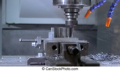Steel car part being produced by robot drill closeup footage