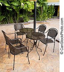 Steel chair in front of restaurant