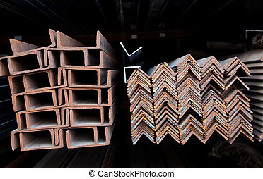 Steel channel U-sections and angles bunch on shelf in warehouse