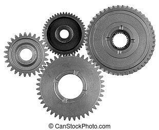 Steel cog gears - Four metal gears on plain background