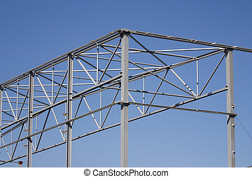 Steel construction - supports across the blue sky