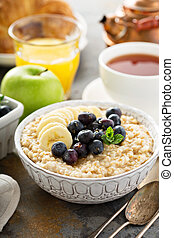 Steel cut oatmeal porridge with banana and blueberry for ...