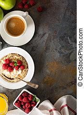 Steel cut oatmeal porridge with raspberry and coconut