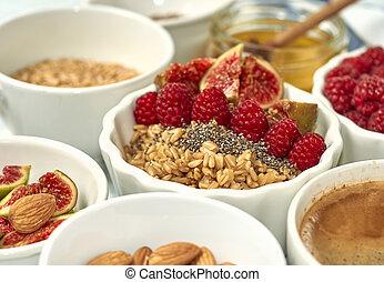 Steel cut oatmeal porridge with raspberry and nuts for breakfast