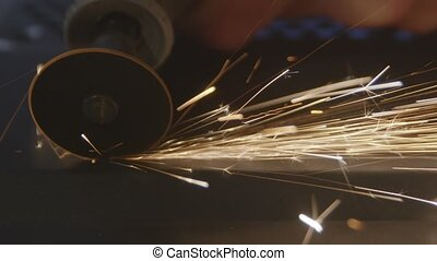 Steel cutter with sparks while cutting steel bar closeup