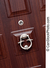 steel door eyelet detail with metal knob